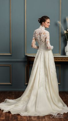 amare couture spring 2017 bridal long sleeves high neck heavily embellished bodice elegant conservative a  line wedding dress with pockets covered lace back chapel train (aurelia) bv -- Amaré Couture Spring 2017 Wedding Dresses