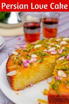 Persian love cake is moist, spongy and will enchant you with its exotic flavors of rose, cardamom, saffron. Luxuriously packed with almonds and sprinkled with pistachios, it is so easy to make! Great recipe for a traditional dessert to serve for wedding p Persian Desserts, Persian Recipes, Just Desserts, Delicious Desserts, Eid Dessert Recipes, Party Desserts, Love Cake Recipe, Rose Water Cake Recipe, Iranian Food