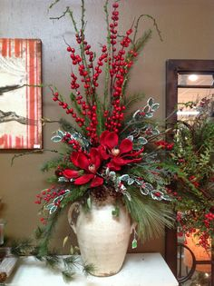 christmas arrangement in a vase