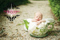 Baby in tea pot