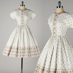 vintage 1950s dress . polished cotton . colorful motif print . bow tie accents . 4646