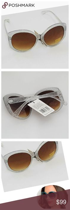 Retro Chic Clear Sparkle Oversize Sunglasses NWT Boutique sunglasses, clear retro chic style with oversized look and silver sparkle and brown/tan/gold lens. Stylish celebrity eyewear.   * UV protection reduces red rays * Absorbs 100% of UVA and UVB rays, filtering colors * High level visible contrast * New with tags, individually packaged. Retro Chic Accessories Sunglasses