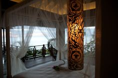 Zenza lights in bedroom overlooking the sea in Villa Susanna, Caribbean by Nomade architettura  www.nomadearchitettura.com