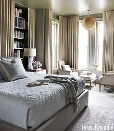 seating area and long curtains in an elegant bedroom...... Love this room