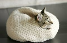 Put your crocheting skills to use by making this super cute DIY cat cocoon for Mittens. http://moderncat.com/articles/diy-crochet-cat-bed/67794