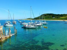 A few boats in the Harbour bathing in the Herm sun today.  Herm island, Channel Islands, UK