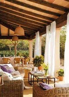 Who couldn't relax on this covered back patio with flowing drapery?
