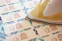 I've been told before that I need to make tags for my handmade items... this is the perfect tutorial for fabric labels!