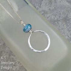 Blue Swirl Glass Bead Sterling Silver Pendant - Hammered Circle by KSJewelleryDesigns