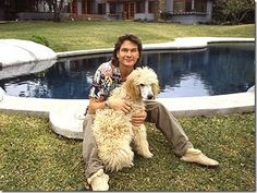 Patrick Swayze with poodle. Portrait taken from 1987.