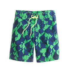 Boys board shorts in tropical fish print