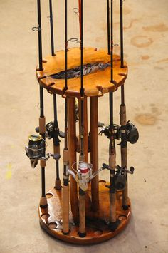 "Solid Mesquite rod and reel holder. This Rod holder holds 16 rods and has a individual lock for each rod.  Mounted on a ""Lazy Susan"" so the entire unit spins to get the equipment in front of you."