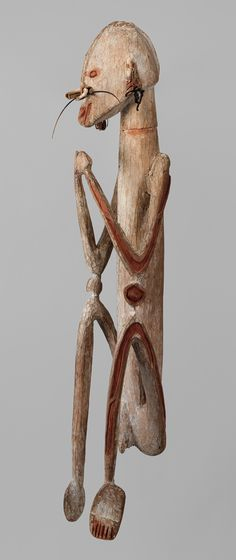 Male Figure, early to mid–20th century Asmat people, Munu village, New Guinea, Papua (Irian Jaya) Province, Indonesia Wood, paint, fiber, shell, cassowary quills; H. 49 1/2 in. (125.7 cm) The Michael C. Rockefeller Memorial Collection, Bequest of Nelson A. Rockefeller, 1979 (1979.206.1589)