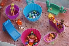 "Great idea to use small world toys & silicone bakeware in the water tray ("",)"