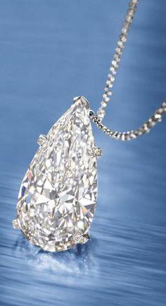 17.62 carat D color, flawless clarity diamond pendant on a necklace.