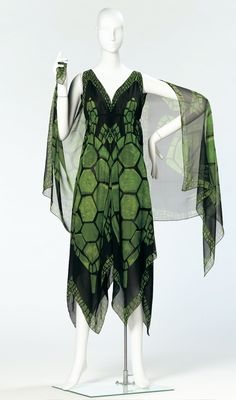 """Dress, Pauline Trigere (American, 1912-2002): 1965, printed silk chiffon. """"In each collection, Trigere designed a garment with a turtle print. In the dress shown here, Trigere's signature motif adorns a collection of scarves that were fashioned to a dress. Two scarves form the front and two form the back creating a perfect handkerchief hemline. Additional scarves are attached at each shoulder forming a flowing cape."""""""