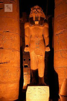 Illuminated Pharaoh Statue at night, Luxor Temple, Egypt