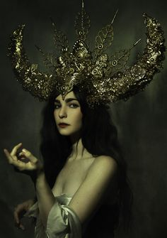 Photo: Elizabeth Elder Photography Model: Victoria Elder Headdress: Miss G Designs  #headdress #headpiece #horns #goldcrown #fineartphotography #portrait #missgdesigns