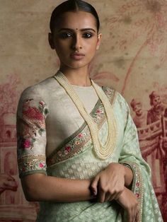 Raw silk blouse in ivory with embroidery and a pale sea green pastel hued saree with self pattern from - Of August 2016 Sari Blouse Designs, Saree Blouse Patterns, Ethnic Fashion, Indian Fashion, Indian Dresses, Indian Outfits, Saree Look, Elegant Saree, Indian Attire