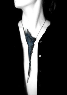 Modern statement necklace with elegant elongated feather-shaped pendant // Emma Ware