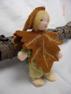 Maple Leaf and seedpod child for Waldorf Fall Seasons Table askance view
