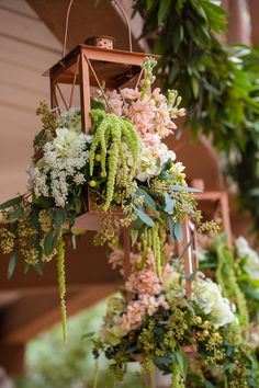 Hanging brass lanterns filled with flowers | Manstrom Photography | see more on: http://burnettsboards.com/2014/05/hitched-western-wedding-inspiration-shoot/