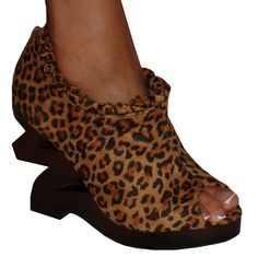 Funkstown-Keep things moving at a brisk pace with these lively shoes. The brushed fabric design has a ruffled top and a leopard inspired print. A sculpted, 4.5 inch wedge heel with a wood grain look adds visual intrigue, while the back zipper ensures a diva worthy strut
