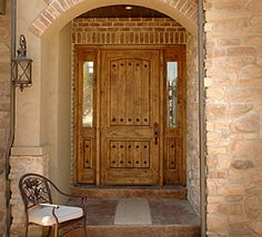 Rustic knotty alder entry doors with sidelights clearance for Wood entry door manufacturers
