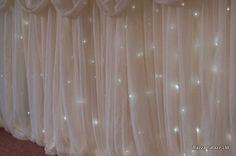 Fairy lights under a chiffon tablecloth would look so pretty