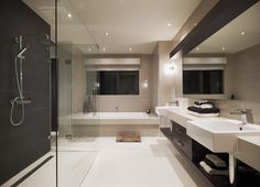 Beige floor tiles with charcoal feature wall