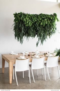 White and wooden wedding table with hanging greenery chandelier | Florals by Foraged | Photograph by Wesley Vorster Photography |