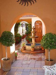 Matched Potted topiaries, fountain, arches
