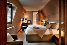 Arredare la camera da letto in mansarda - La camera nel sottotetto ...