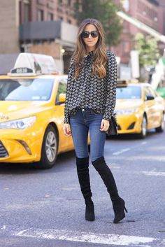 Arielle Nachami's over the knee boots look sleek and sophisticated with skinny denim jeans and a chiffon blouse. Jeans: L'Agence, Boots: JOIE, Shirt: Isabel Marant, Bag: Valentino, Sunglasses: Bottega Veneta.