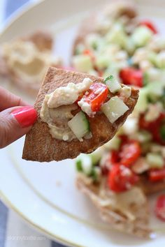 A lighter, healthier Greek twist on traditional nachos – made with whole wheat pita chips, hummus, cucumbers, tomatoes and feta.