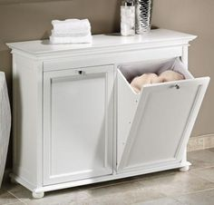 """Hampton Bay Double Tilt-Out Hamper This handsome piece of furniture hides all your home's dirty laundry without screaming """"hamper!"""" I also like that there's space on top to hold detergent or fold clothes after they've been washed."""