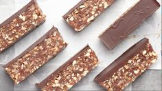 Instead of giving into your cravings, satisfy them with a healthier version of your fave candy—like these vegan Snickers-inspired bars. Paleo Treats, Vegan Snacks, Healthy Desserts, Tasty Snacks, Raw Desserts, Gourmet Recipes, Sweet Recipes, Dessert Recipes, Vegan Recipes