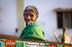 Old Woman Sitting in Wagon - An old woman sitting in a wagon at the end of a hard days work in Kampalapura, India.