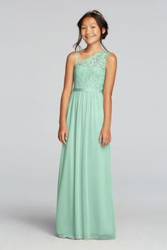 The younger girls in your party will blend seamlessly in this junior bridesmaid dress with a long mesh skirt and one-shoulder lace bodice, plus an optional spaghetti strap.  Attached grosgrain ribbon detail at waist.  Complements perfectly with Bridesmaid Style F17063.  Fully lined. Imported. Back zipper. Dry clean only.