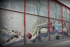 Austrian-based dissection artist, Nychos, recently painted this lengthy sectioned crocodile with a skeleton in its intestines somewhere on a building in Vitry, France.