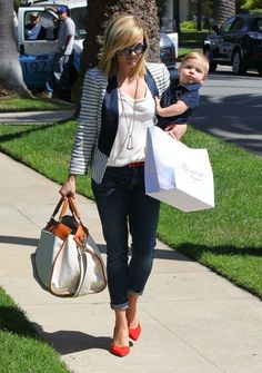 Reese Witherspoon looking festive in her red, white and blue! Get the look: http://www.shopmama.com/products2.cfm/ID/23418/c/blazers #shopmama #stripes #blazer