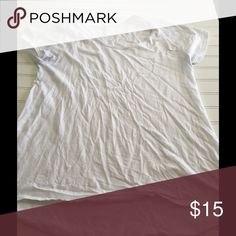 Worn White LuLaRoe Large Classic Tee This Classic Tee, size large, is a true white tee. It has been worn a few times and is tougher fabric. LuLaRoe Tops Tees - Short Sleeve
