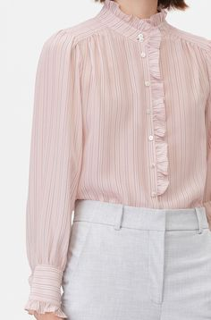 A feminine take on men's shirting, the Tailored Silk Stripe Top is done in a blush hue and trimmed with ruffles that will add a playful twist to any outfit. Stylish Dress Designs, Stylish Dresses, Neckline Designs, Blouse Designs, Girls Fashion Clothes, Fashion Outfits, Camisa Vintage, Baby Dress Design, Sleeves Designs For Dresses
