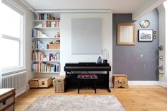 Love the bookshelf and the piano placement