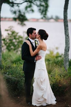 a simple and sweet gown goes perfectly with a classic groom to create an atmosphere of elegance. see more from Kallima Photography here http://kallimaphotography.com/