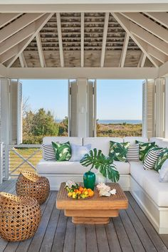 """Breezy Outdoor Retreat - Tour This Breezy South Carolina Beach House - Southernliving. The homeowners, he explained, """"wanted a house that was understated, so it would speak to the spirit of Sullivan's Island, but at the same time they have very sophisticated leanings. The challenge for me was figuring out how to reinvent these elegant moments and details in a simpler, quieter way."""" The resulting design is a series of linked pavilions, each with its own roof, much the way houses have always…"""