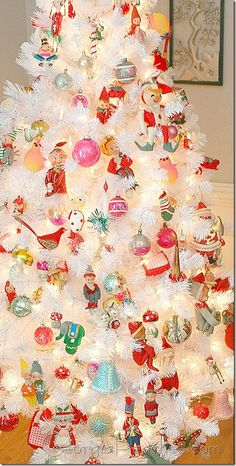 White tree with toyland theme.