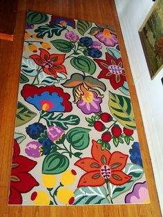 This is a rug made from those hideous foam tiles people use for their kid's rooms/play mats.  What a brilliant idea!