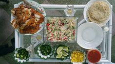 [Homemade] Grilled fish tacos, sides of fresh Jalapeños,pineapples with mango salsa, Chipotle/sour cream white cabbage with chopped grape tomatoes, cilantro,limes, green onions, Flour & Corn toasted tortillas. - Imgur