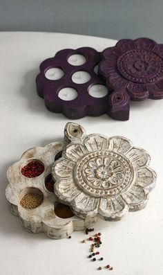Traditional Indian spice boxes with lids that slide back to reveal hidden recesses. Made of waxed, stained wood. Contents shown are not included.